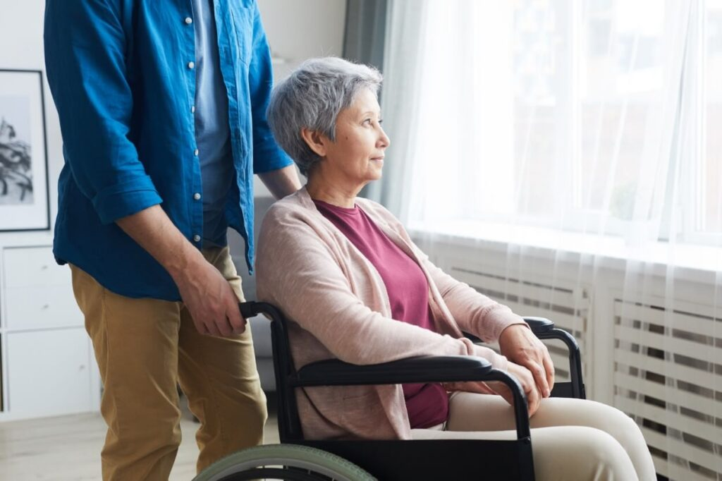 disabled woman in wheelchair TUKL7QL 1